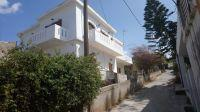 Large and unique property of house and 3 small apartments inside the fishing village of Panormo