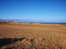 Amazing sea view plot of 500 sq.m for sale in Panormo located next to the beach.